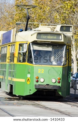 The classic class of green and gold Melbourne trams. - stock photo