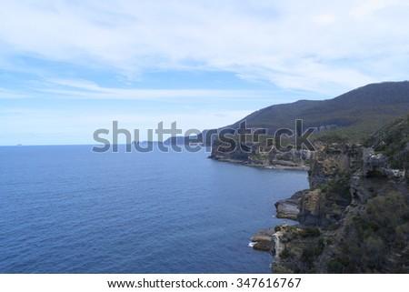 The cliffs of the rugged tasman penisular tasmania - stock photo