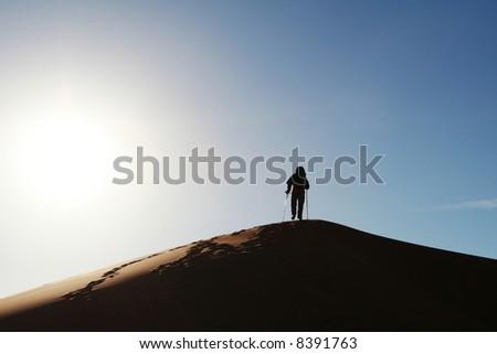the climb on dune - stock photo