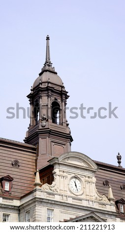 The clock and bell tower on Montreal's City Hall - stock photo