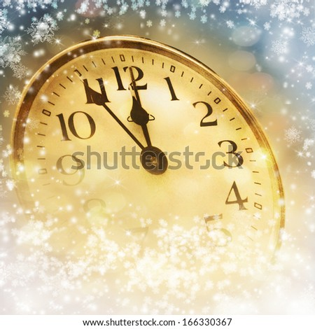 The clock at midnight. New Year background. - stock photo