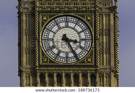 The clock face of Big Ben, in the clock tower of The Houses of Parliament, Westminster, London, England. - stock photo