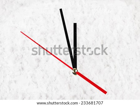 The clock in the snow. Five minutes before the New Year concept. - stock photo