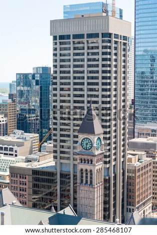 The Clock Tower of the Old City Hall over skyscrapers in the background in Toronto. Aerial view of main highrise buildings or modern architecture of Toronto downtown - stock photo