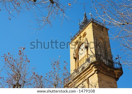The clocktower of Hotel de Ville in Aix-en-Provence, France.  Copy space. - stock photo