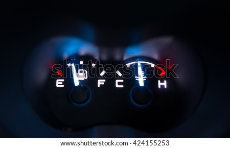 The close up fuel and temperature gauge - stock photo