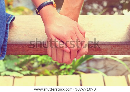 The close up shot of couple hand holding together in vintage style concept of love, care, encourage and relationship - stock photo