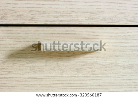 The close up shot of Wood drawer with cream tone color - stock photo