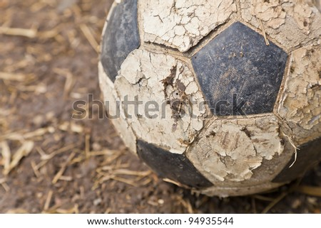 The closeup image of an old ball on the ground - stock photo