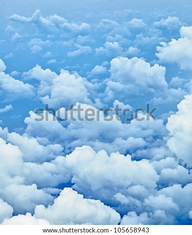 The clouds in the sky - a view from the aircraft cabin - stock photo