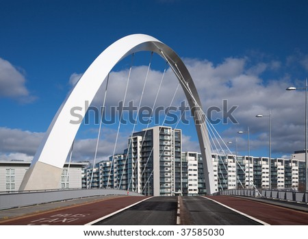 The Clyde Arc or squinty bridge in Glasgow, Scotland, against a blue sky - stock photo