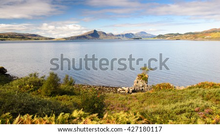 The coast and mountains of the Isle of Skye in the Inner Hebrides of the Highlands of Scotland, looking over the Sound of Raasay bay. - stock photo