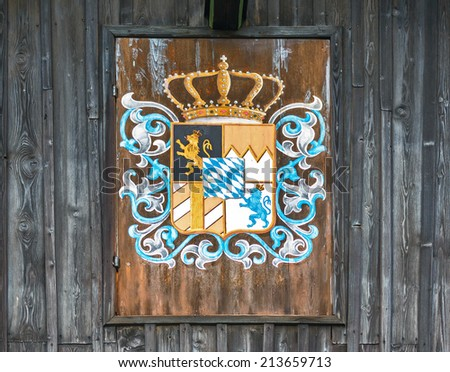 The coat of arms of Bavaria (Bayerisches Staatswappen) on the wall of the old Tyrolean house - Germany - stock photo