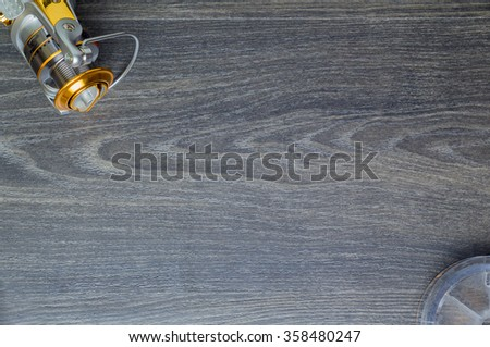 The coil fishing and a scaffold on a table - stock photo