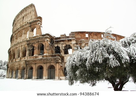 The Coliseum covered by snow, a really rare event in Rome - stock photo