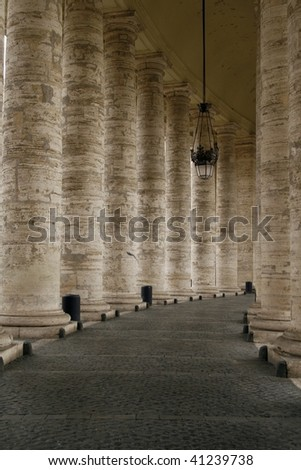 The Colonnade located in the front of the St. Peter's Basilica (Basilica di San Pietro) in Vatican, Rome,  Italy. The columns are surrounding the famous Saint Peter's Square (Piazza San Pietro) - stock photo