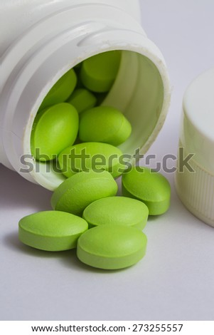 the color pill or just salmon oil capsules - stock photo