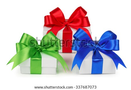 The colored boxes with gifts of different sizes, isolated on a white background - stock photo