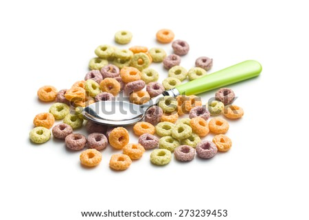 the colorful cereal rings and spoon - stock photo