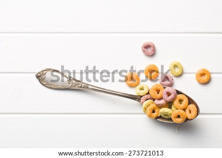 the colorful cereal rings in spoon - stock photo