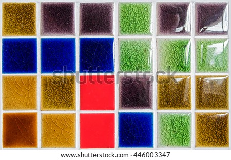 The colorful clay ceramic  tiles with glazed surface (coating) Yellow,Red,Dark brown,Green and blue color, products of the northern Thailand  - stock photo