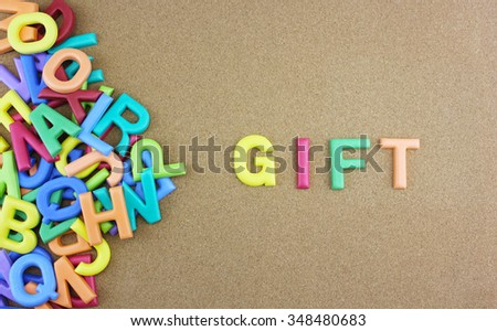 """The colorful word """"WORDS"""" next to a pile of other letters over the brown board surface composition. - stock photo"""