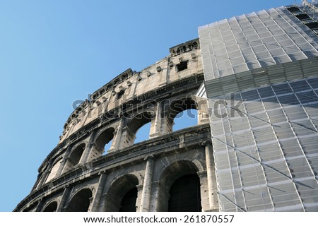 The Colosseum in Rome with restore works in progress on the facade. - stock photo