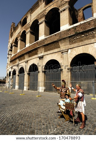 THE COLOSSEUM, ROME- SEPTEMBER 9: Street performers dressed as centurions perform for tourists, September 9, 2008 in Rome, Italy. - stock photo