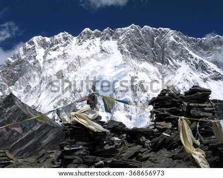 the colourful prayer flags under Mount Lhotse in the Himalayas - stock photo