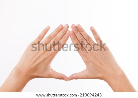 The combined hands, are forming a triangle  - stock photo
