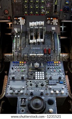 The complex throttle controls in a 747 jumbo-jet cockpit. - stock photo