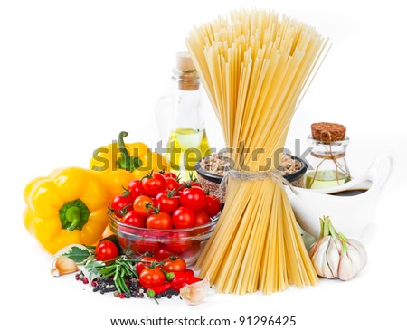 The composition of the pasta and vegetables on a white background - stock photo
