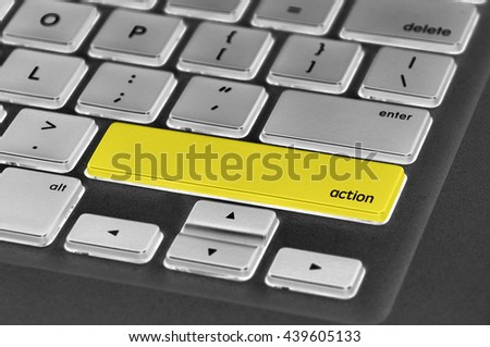 The computer keyboard button written word action. - stock photo