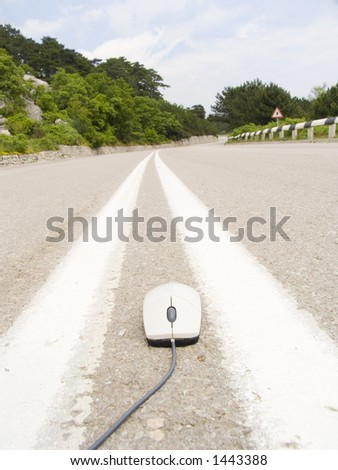 The computer mouse runs on an automobile line - stock photo