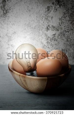 The concept eggs energy light bulbs. - stock photo