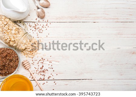 The concept of cooking oatmeal with flax seeds. Background. - stock photo