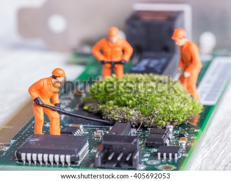 The concept of error correction or repair your computer. Miniature toy engineers fixing error on chip of motherboard.  Close-up view. - stock photo