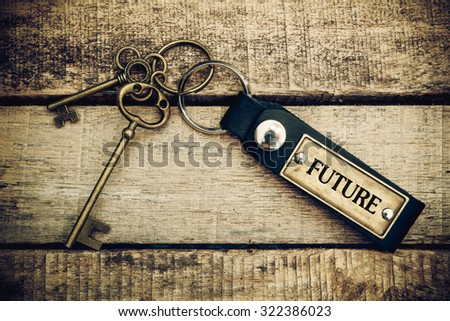 The concept of 'future' is translated by key and silver key chain - stock photo