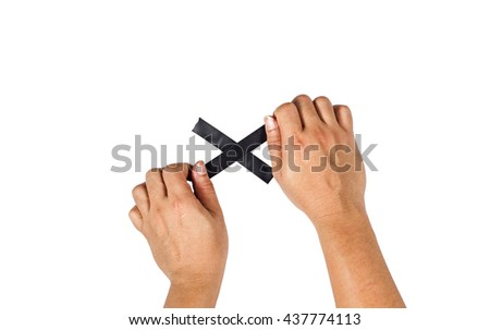 The concept of hands is about to taped to a black cross. - stock photo
