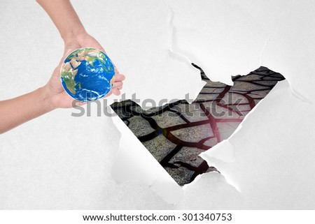 The concept of love, protect the earth, before the drought will be destroyed.  (Elements of this image furnished by NASA) - stock photo