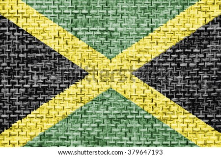 The concept of national flag on canvas jute fabric background: Jamaica - stock photo