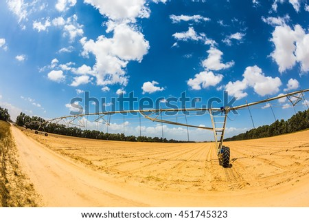 The concept of progressive agriculture. Installation of automatic irrigation fields - stock photo