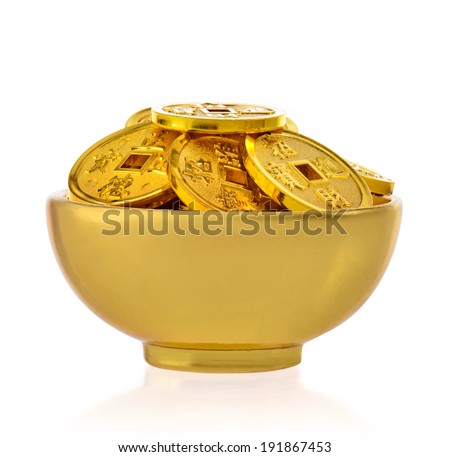 The concept of wealth , bowls and gold coins - stock photo