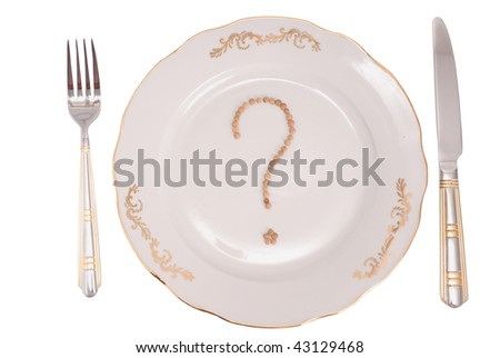 """The conceptual image on a theme """"What to eat?"""". A set of tablewares on a white background. On a plate the sign on a question from lentil is laid out. - stock photo"""