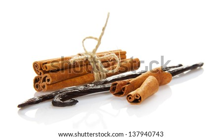 The connected cinnamon and the vanilla pods, isolated on white - stock photo