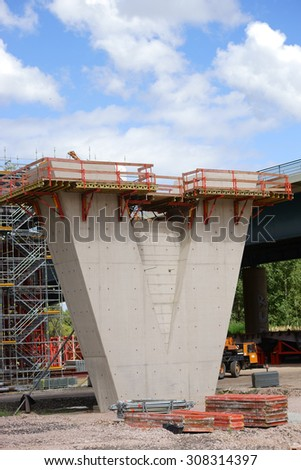 The construction of a new highway bridge with a V-shaped concrete beam / Bridge construction site            - stock photo