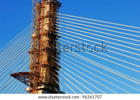 The construction of cable-stayed bridge - stock photo
