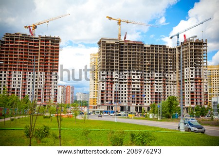 The construction site. Construction of the new building. Construction cranes - stock photo