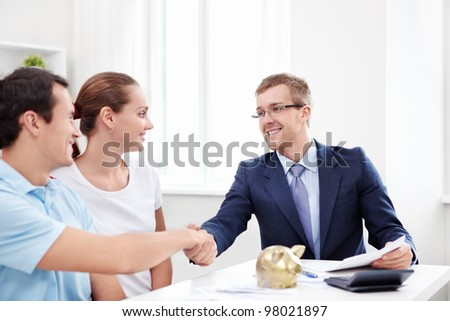 The consultant shakes hands with a man - stock photo