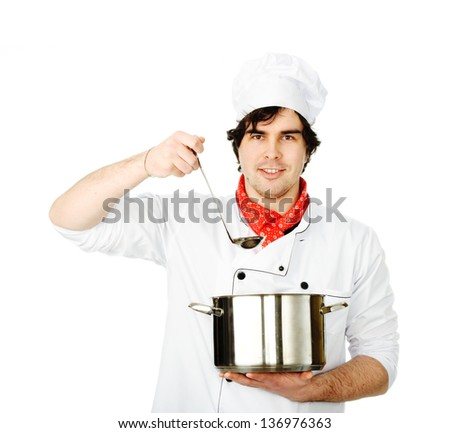 The cook prepares in the big pan - stock photo